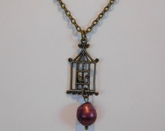 Burgundy freshwater pearl and birdcage charm on 18 inch chain with a sparrow
