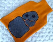 Hot water bottle cover, Vintage blanket, tiki design, black and orange