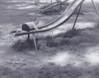 Vintage Photo Fun Photo Boy Climb Playground Slide Snapshot Photo Family Kid Play City Park Old Photograph Black And White Photo 1960s C681