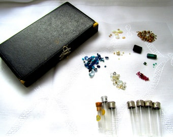 Vintage box with 9 small glass tubes with jewel stones