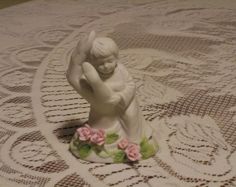 Touch Of Rose By, Roman Inc.  Holding A Sleeping Child