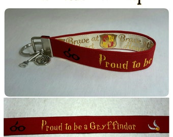 Embroidered Harry Potter Hogwarts Gryffindor Key Fob/Wristlet with Charms and Brave at Heart Ribbon - Ivory
