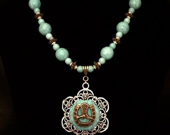 Turquoise flower cowgirl necklace