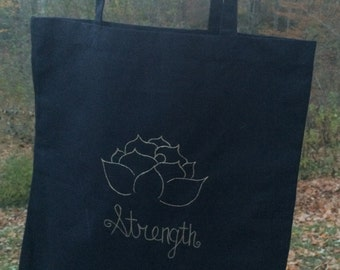 Black Canvas Tote with Lotus Strength Design