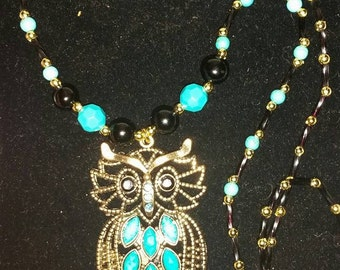 Blue, Black and Gold beaded Necklace with Gold Tone Owl Pendant.