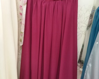 Long bridesmaid style dress with one shoulder ruffle, dark pink