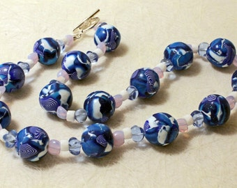 Hand made polymer clay beaded fashion necklace in a delightful blue and white.