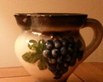 small vintage pottery jug with grape detail