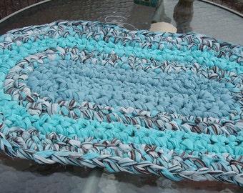 teal an blue rag rug