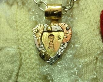 Handmade sterling, brass, copper heart