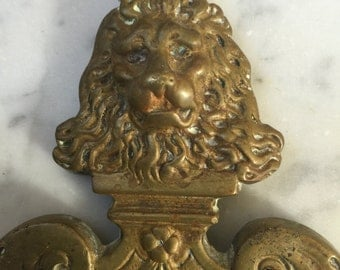 Plaque, crest, fleur de lis, lion with crown, metal, brass, heraldry, lion, found object, 3 1/2 x 6, hanging