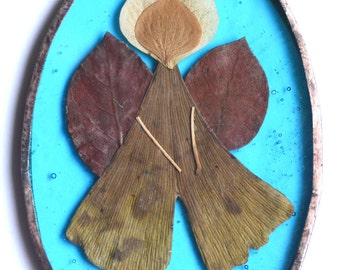Stained glass angel made of colorful leaves and petals