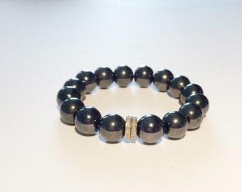 Hematite gemstone and 0,22 carat pave diamond bracelet