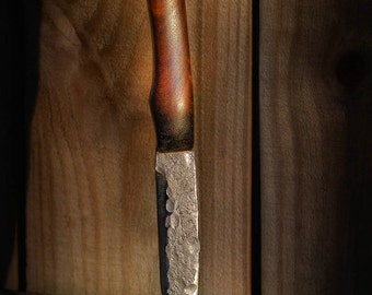 Handforged Primitive Frontier style knife with carved leather sheath
