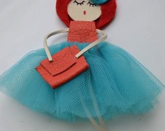 Doll brooch