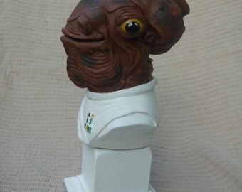 Statue or figure inspired by Admiral ACKBAR, Star Wars character.