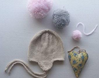Beige handmade bonnet.