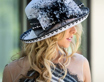 Black & White Bow Hat With Feather Accents