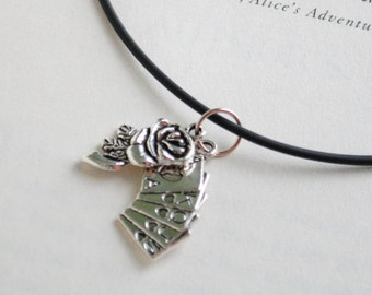 Alice in Wonderland themed string necklaces; Deck of cards and roses