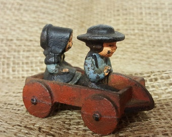 Cast Iron Amish Boy and Girl In Wagon Old Toy Vintage Toy Collectible Toy Miniature Toy