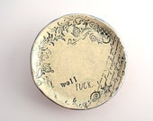 small plate/saucer with cursing and floral stamps