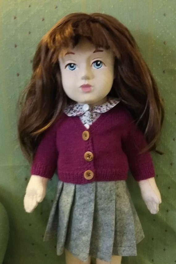 Doll's outfit with skirt, cardigan and shirt