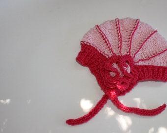 The Aviatrix Baby Hat in pinks, 1-2 years