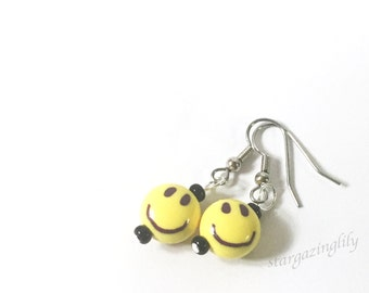 Emoji Earrings. Smiley Face Emoji Bead Earrings. Hypoallergenic surgical steel hooks or clip-on's. Yellow Face Emoji Jewelry Have a nice day