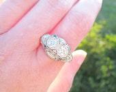 1920's Art Deco Diamond Ring, Old European Cut Diamonds, approx. .85 ctw, Fancy Platinum Filigree, Blue Sapphire Accents, Hand Engraving