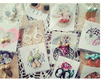 25 pairs of earrings. Wholesale boutique lot stocking stuffers.