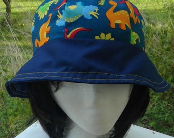 Reversible cotton bucket hat with dinosaurs and stripes