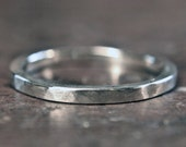 Recycled sterling silver 2mm wide wedding ring. Heavy planished finish. Hand made in the UK.