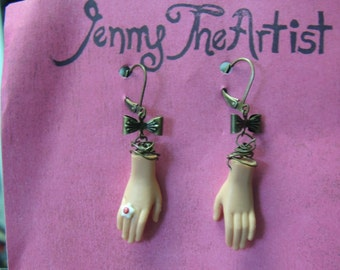 Dangle Barbie Hand, Brass bow, wire-wrapped Earrings