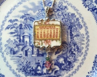 Broken china jewelry pendant necklace December birthday 1921 calendar plate with Swarovski crystal drop
