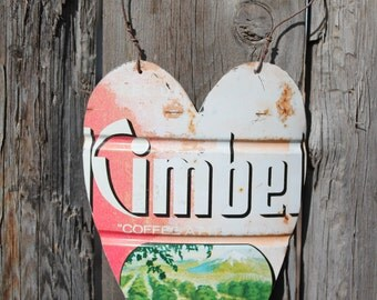hanging heart cut from rusty vintage Kimbell's coffee can kitsch wall decor