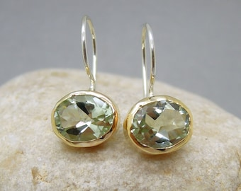 Green amethyst earrings set in yellow gold
