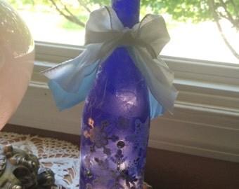 Wine bottle lamps,lighted bottles, lighted wine bottles, snowflake, snowflakes, wine bottle lights, wine bottles with lights,lighted bottles