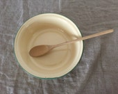 Large yellow VINTAGE enamel ware bowl and wooden spoon. Vintage kitchen / vintage home.