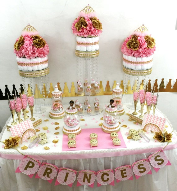 pink and gold baby shower candy buffet with tiara crowns and baby
