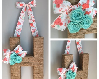 The Original Jute Monogram Wreath. Jute Letter Wreath featuring coral and mint floral ribbon and mint rosettes