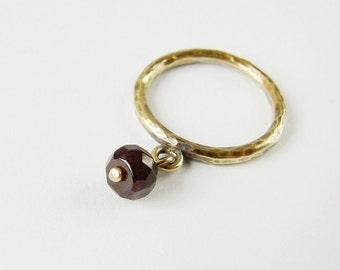 Garnet dangle charm ring. Antique gold tone brass stacking ring. Boho chic handamde jewellery.