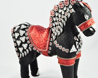 Intricately Designed Black and White Horse Sculpture with Bronze saddle, silver chain, and Swarovski Crystal Studded