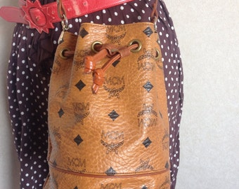 Vintage MCM brown monogram small hobo bucket bag. mini purse. So chic and cute. Designed by Michael Cromer.