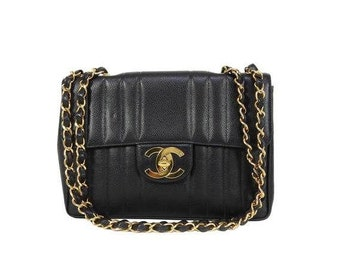 MINT. Vintage CHANEL black caviarskin 2.55 classic jumbo, large chain, large shoulder bag with golden CC. Vertical stitch.