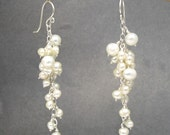 Dangling cluster of freshwater pearl earrings Cosmopolitan 10