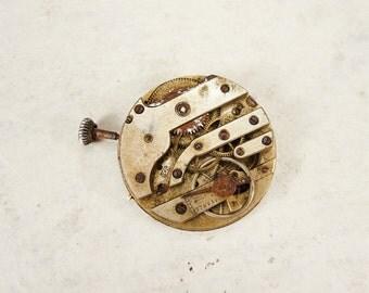 Antique Brass Pocket Watch Movement with porcelain face - c16