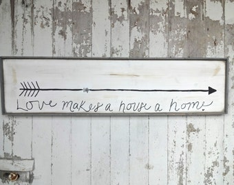 Love makes a house a home rustic wood sign with arrow