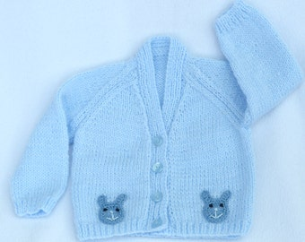 Baby sweater. Baby hand knitted pale blue baby cardigan to fit 3 to 6 months