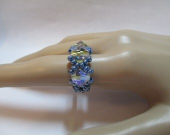 Ring with light blue cream beads with three 8MM AB crystals on stretchy cord size 7, 8