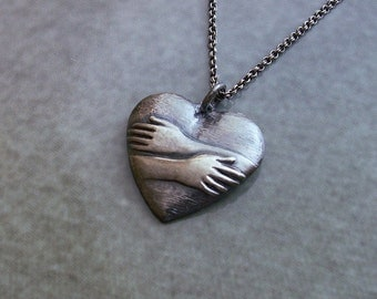 Silver heart necklace, heart jewelry, Silver anniversary, Valentine's Day, hugging heart, silver jewelry,  hugging heart, PMC jewelry